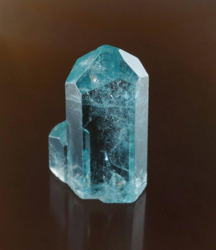 Beryl var aquamarine. 20 mm choice terminated crystal with smaller crystal in parallel growth. Kaduna State, Nigeria.