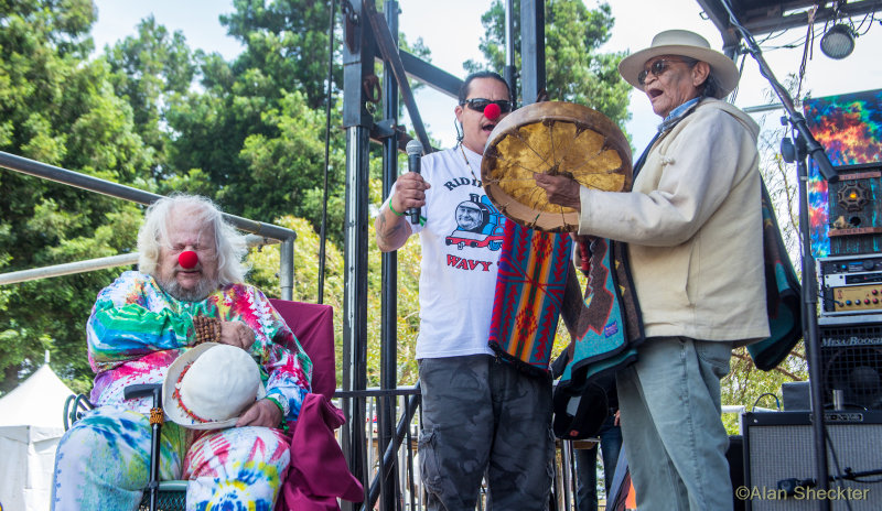 * Wavy Gravy listens to Quiltman as he honored the late John Trudell