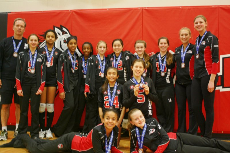 Photo of Durham Attack's 13U girl's volleyball Heat with their medals after wining the bronze at the OVA McGregor Cup