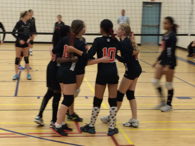 Photo of Durham Attack 13U Heat embracing team spirit during Waterloo Tigers 14U Invitational Tournament.
