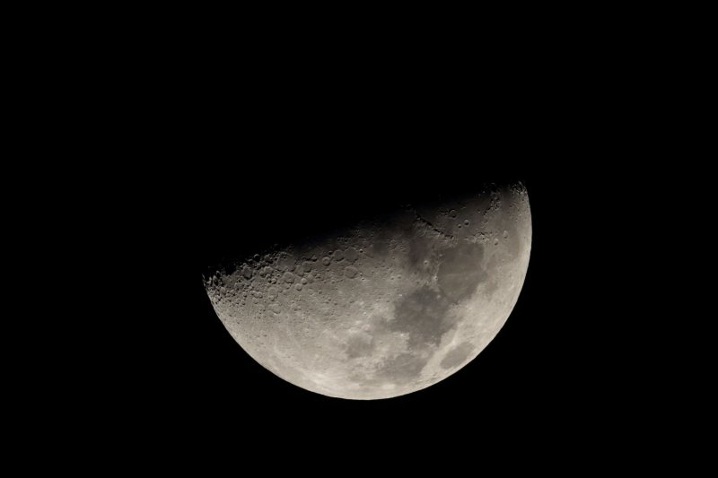 Moon covering Saturn