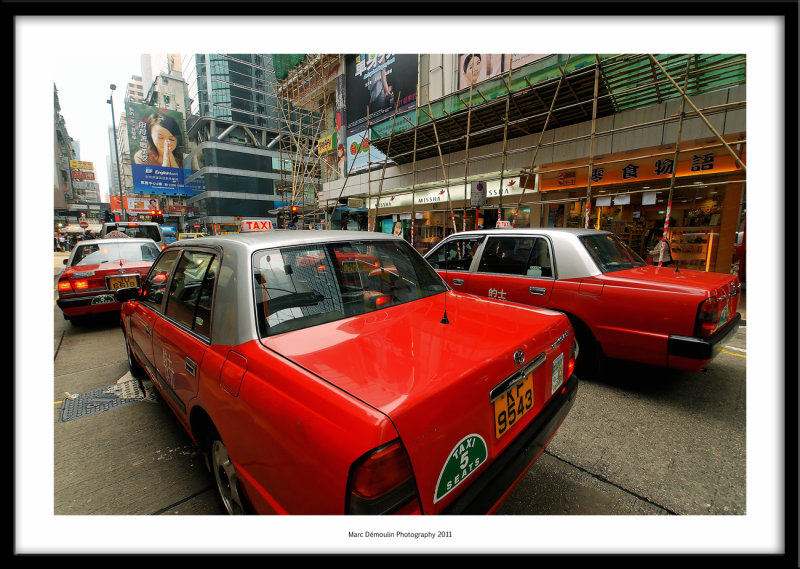 Red cabs and bamboo scaffoldings, Hong-Kong 2011