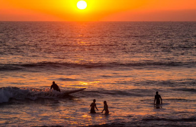 Surfers at sunset, Imperial Beach, California, 2014