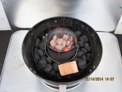 Hot coals added to bottomless paint can.
