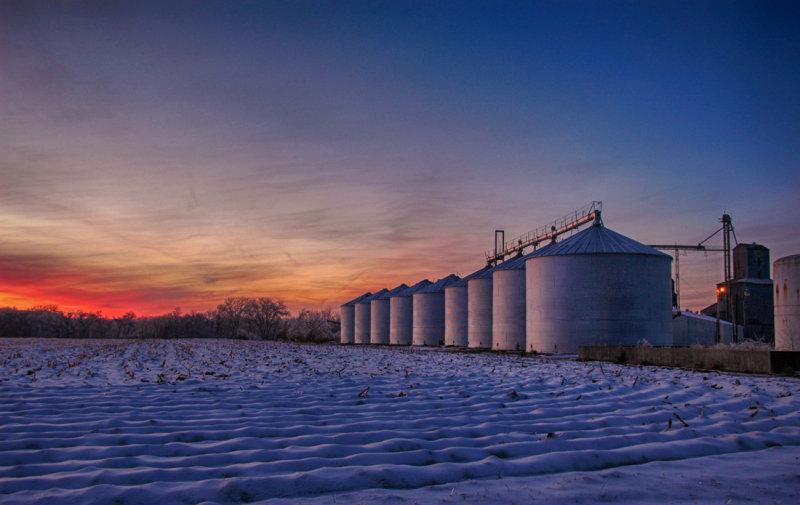 Sunset Reflections in Grain Bins