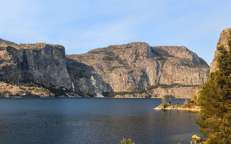 Looking across the Hetch Hetchy Valley Reservoir at Wapama Falls and Hetch Hetchy Dome in Yosemite National Park