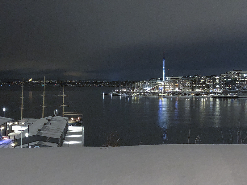 Oslo harbor, with a ski run in the distance