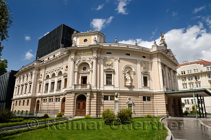 Neo Renaissance architecture of the Slovenian National Opera and Ballet Theatre of Ljubljana Slovenia in sun after a rain storm