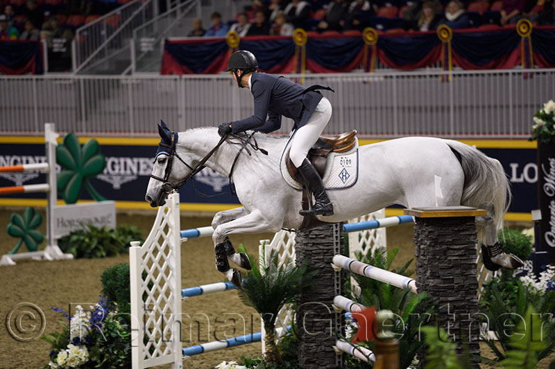 McLain Ward riding HH Gigis Girl at the McKee Family International Jumper Competition at the Royal Horse Show Ricoh Coloseum To