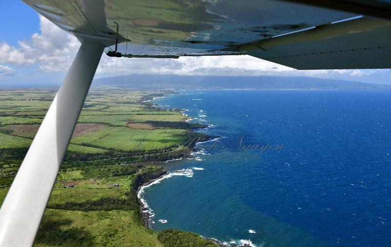 Looking toward Paia and Kahului,  Mauna Kahalawai (the West Maui Mountains)