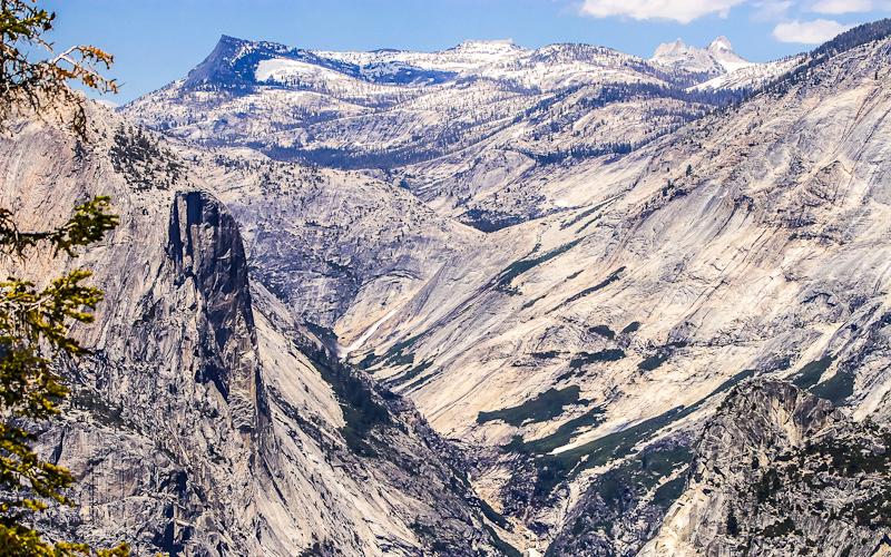 Tenaya Peak (10,700 ft.), Tresidder Peak, the Echo Peaks (11,040 ft.) and the granite Yosemite Valley in Yosemite National Park