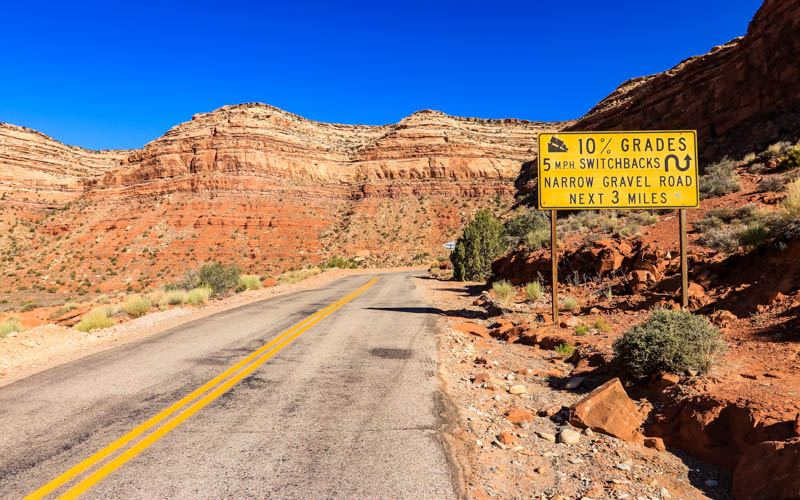 Warning sign at the base of the Moki Dugway dirt switchbacks in Valley of the Gods