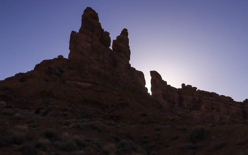 The sun sets behind the Rudolph and Santa Claus formation in Valley of the Gods