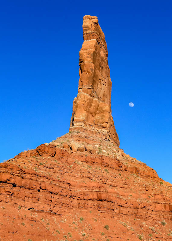 The moon behind Castle Butte in Valley of the Gods