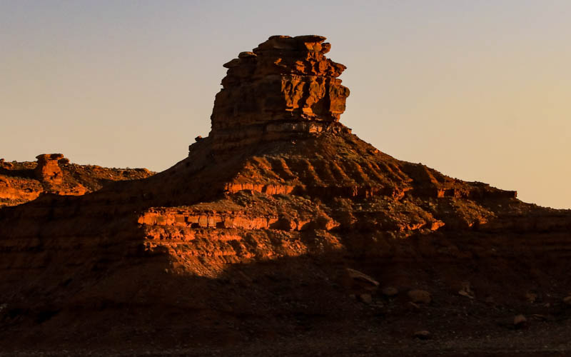 Jagged rock formation at sunset in Valley of the Gods