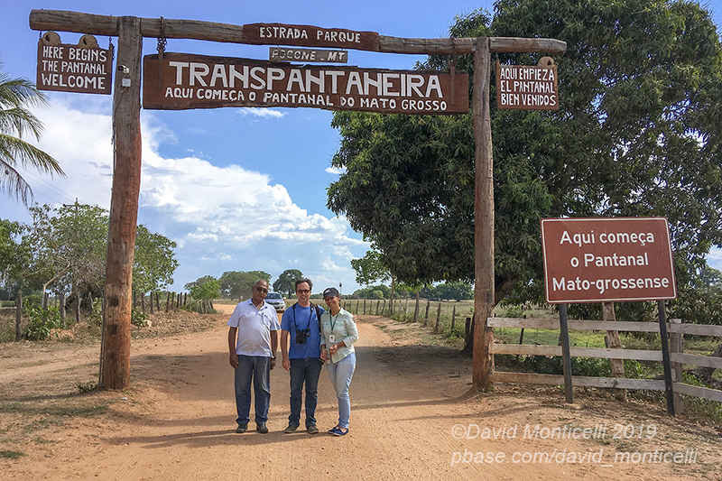 Group photo (Driver, myself and our official tour guide Lorinete) at the entrance of the Pantanal, south of Poconé (Mato Grosso)
