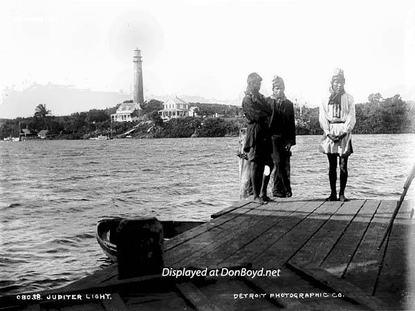 1887 - Seminole Indians at Jupiter Inlet with Jupiter Light in the background