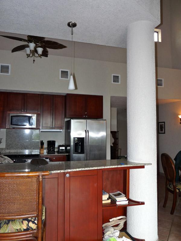 Bar stools facing the kitchen