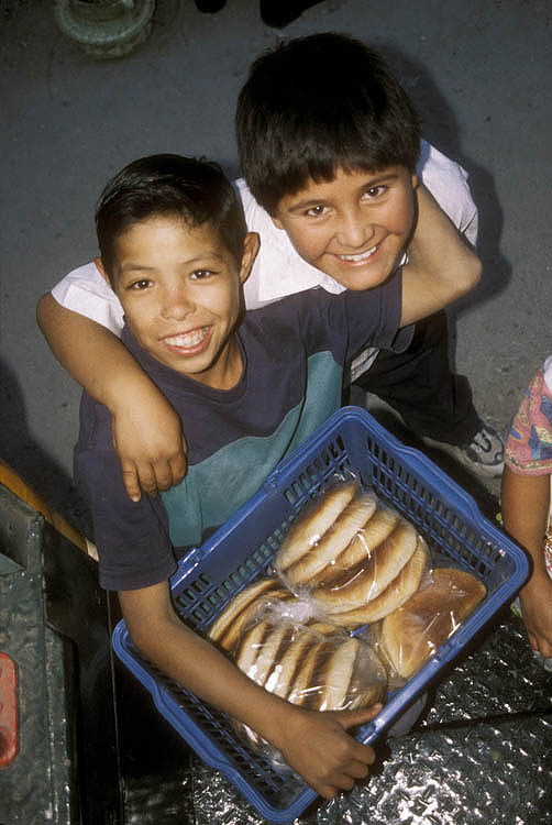Boys selling bread along the line