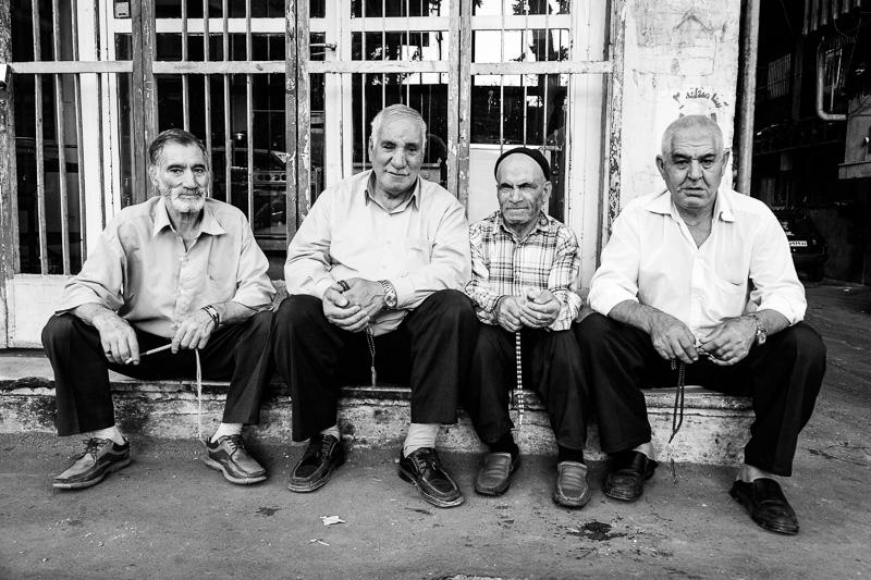 Four men with prayer beads - Tehran