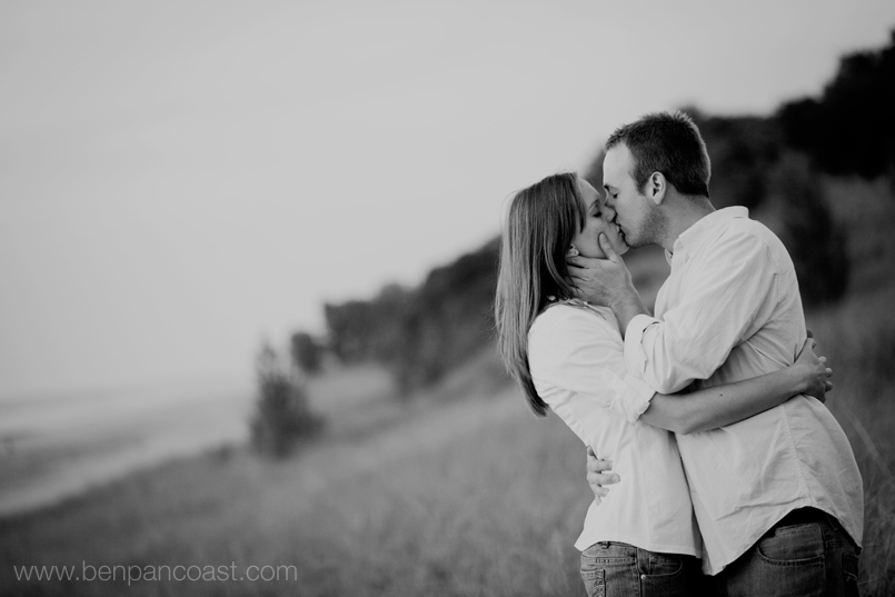 Engagement photo on the beach at dusk.