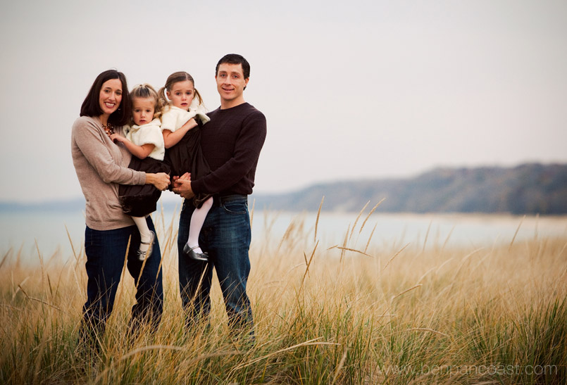 Family portraits by the lighthouse at Tiscornia Beach in Saint Joseph Michigan.