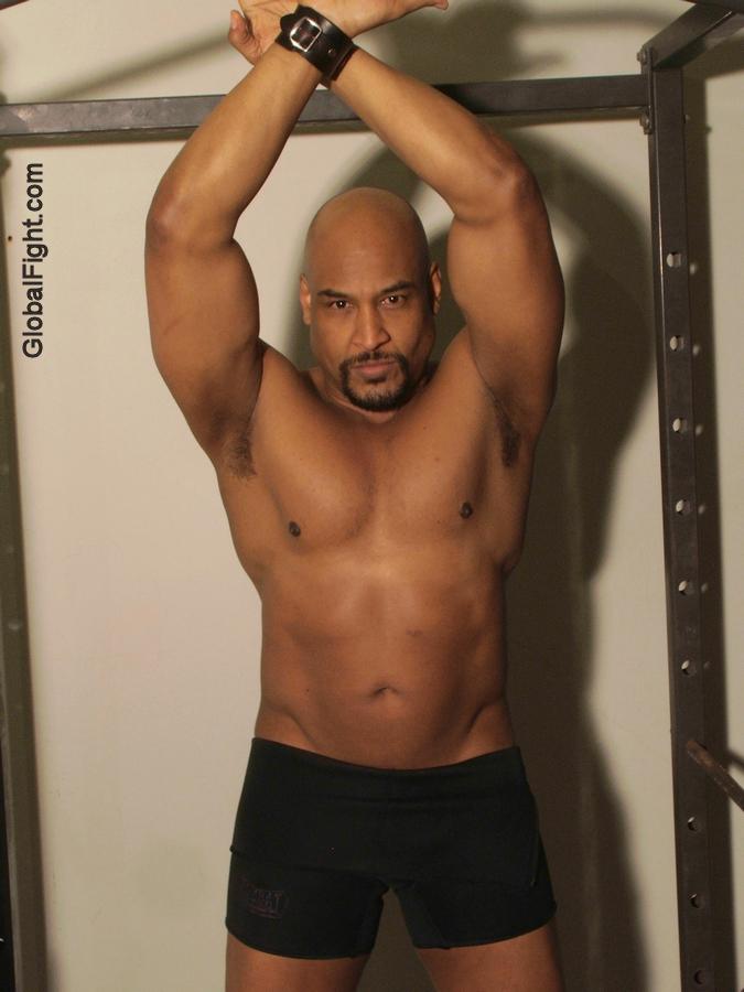 body builder arms raised bondage bdsm black man.jpg photo