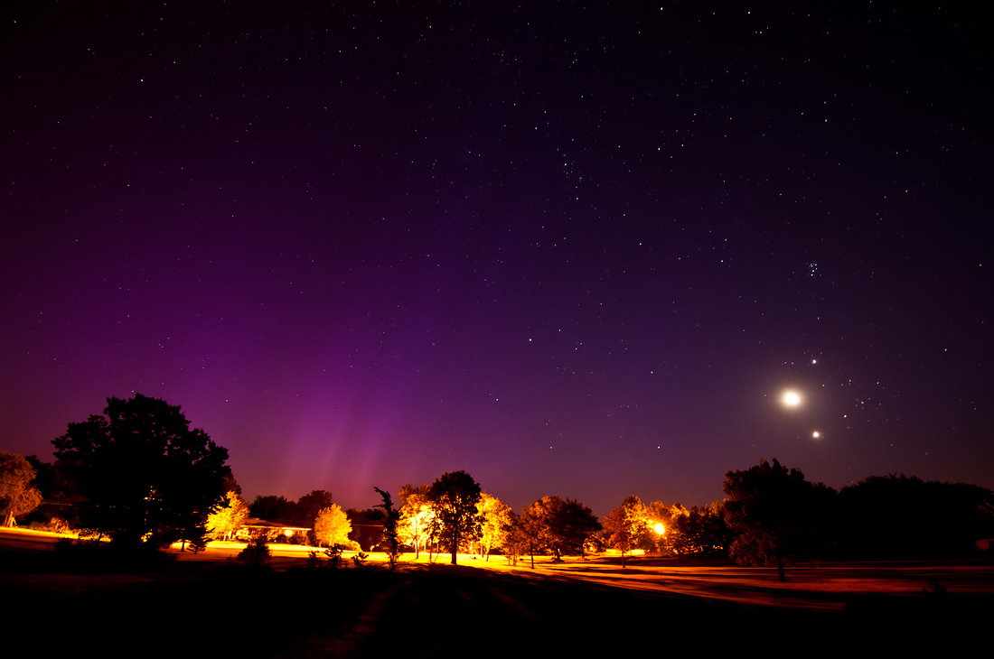 Planetary Conjunction with Auroras