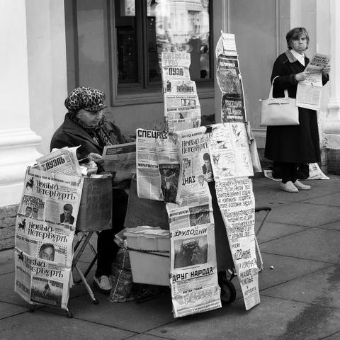 Newspaper lady