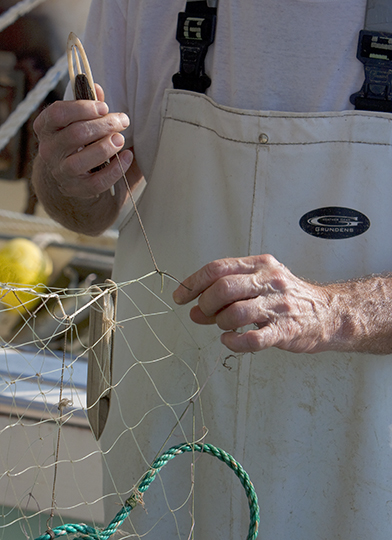 Another  Fisherman Repairing A Net