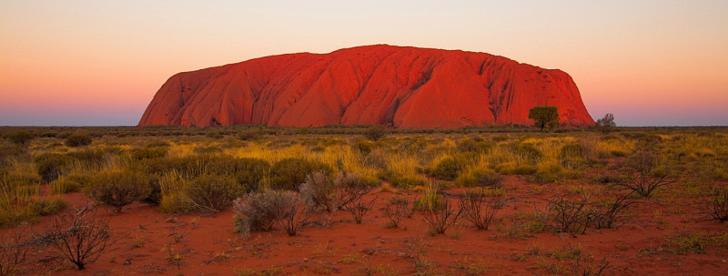 Uluru lit up by the very last bit of sunshine