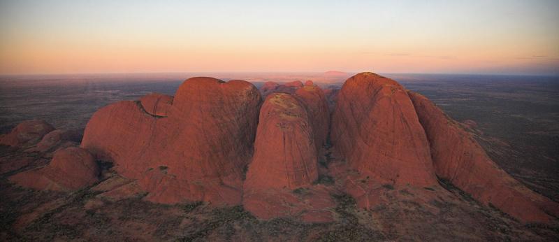 Domes of Kata Tjuta at sunset - Uluru in the background