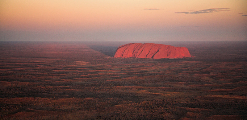 Uluru and the red desert from above
