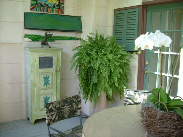 On the back porch; lovely touches (she deals in antiques)