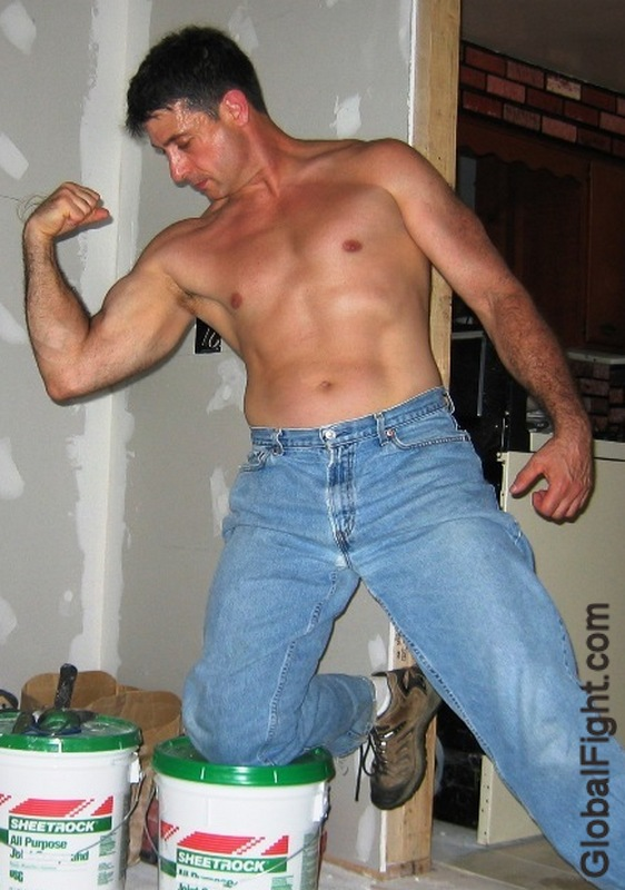 plastering wallpappering man shirtless flexing.jpg