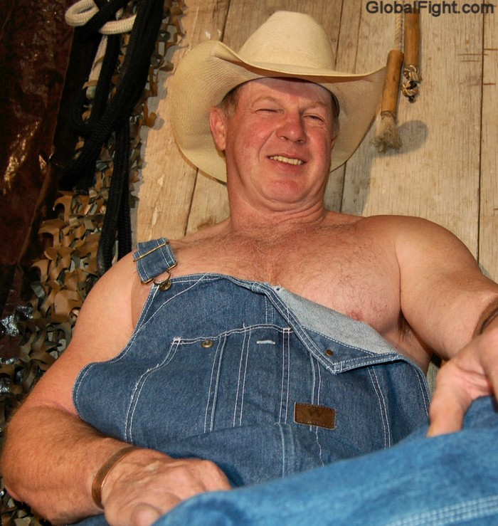 big happy smiling cowboy daddy wearing coveralls.jpeg
