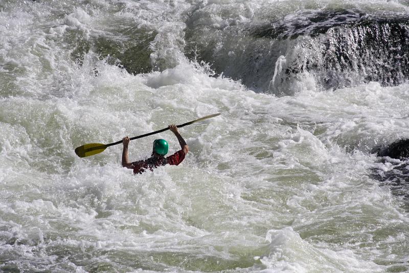 Surfing Kayaker