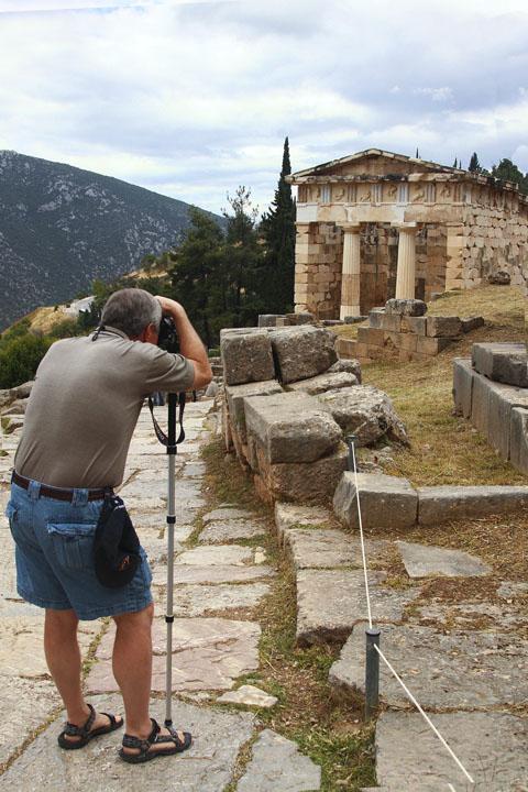 Delphi - photographing the Athenian Treasury.jpg
