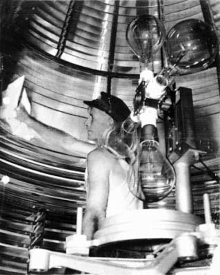 1930s - Fowey Rocks Lighthouse Keeper Hamilton Hamp Sharpe Perry polishing the Fowey Rocks Light Fresnel Lens
