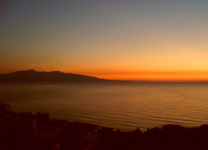 sunset with corfu island, from my balcony in saranda