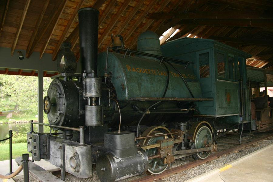 A steam locomotive in the Adirondack museum.