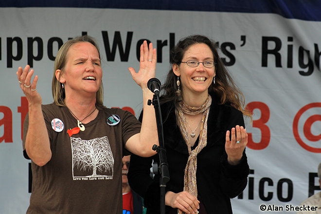Sherri Quammen (left), and Mandalyn May  lead a sing-along version of If I Had a Hammer