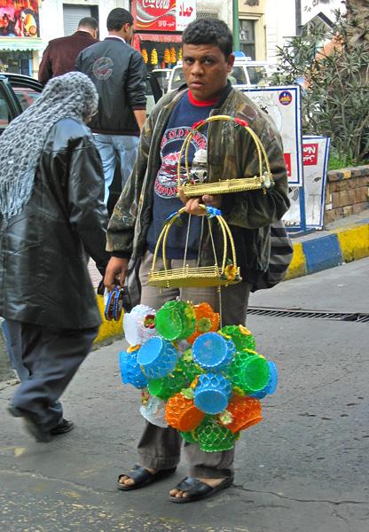 A street vendor of baskets and plastics<br>4437
