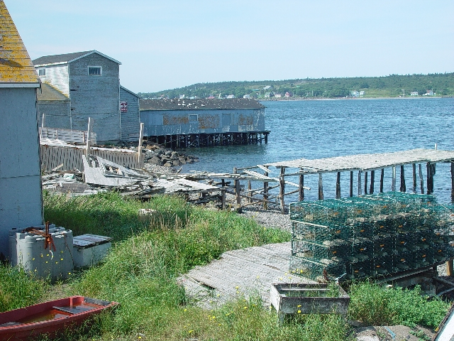 AN ABANDONED FISH FACTORY ON THE WAY-NOTICE THE LOBSTER TRAPS ALL IN A ROW