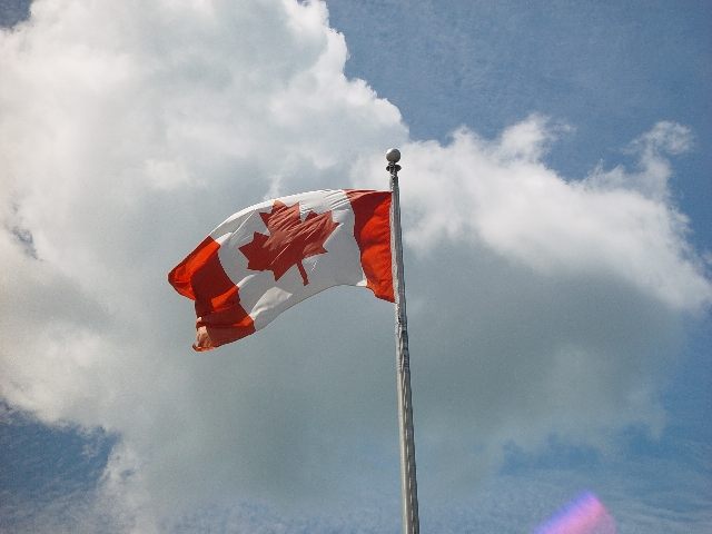 THE CANADIANS ARE PROUD PEOPLE AND FLY THEIR FLAG
