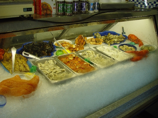 A FISH SHOP ON BRIERS ISLAND HAD OYSTERS, SALMON, THOSE GIANT SCALLOPS, HADDOCK, CRAB, LOBSTER AND COD JUST TO NAME A FEW..