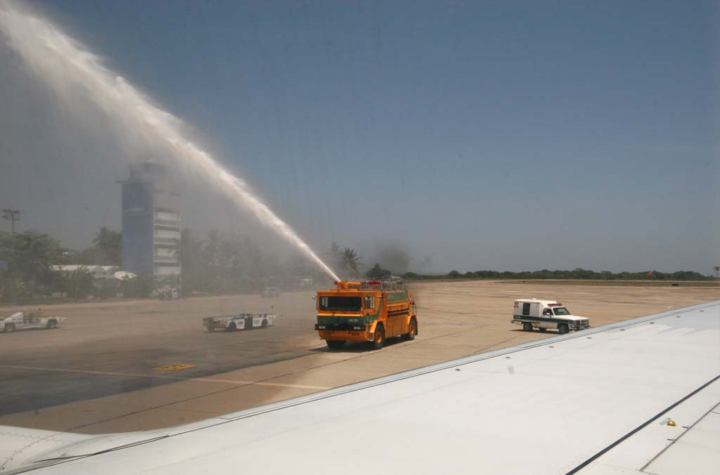 Welcome to Acapulco (by firetruck spray of water over plane)