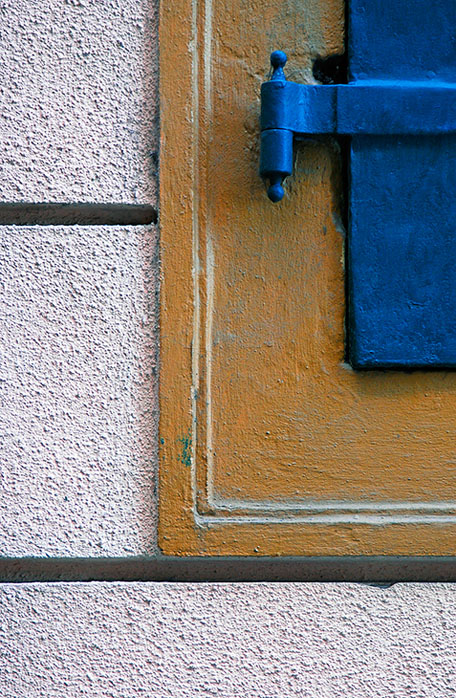 Blue Viennese Window with Yellow Border and an almost White Wall