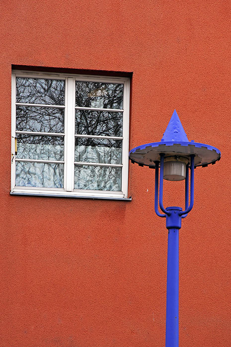 The blue lamp, the red wall, the white window