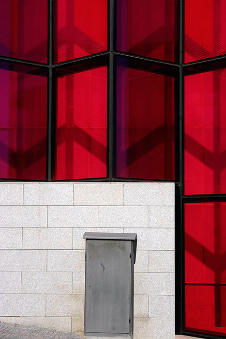 The gray door within the red transparent wall